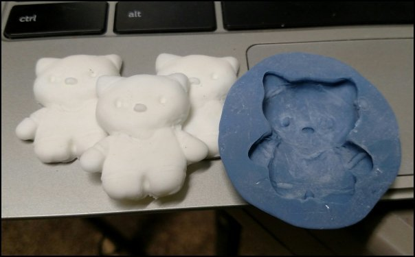 Resin Hello Kitty casts and 100% Silicone Caulk Mold
