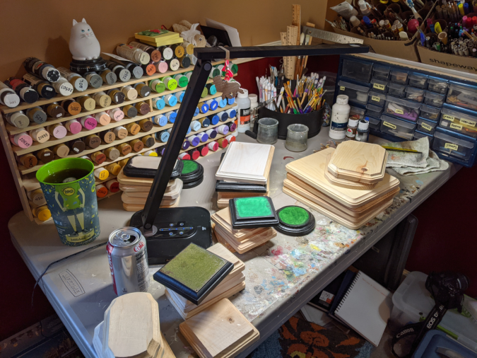 Photo of my very messy workbench with model horse base making materials.